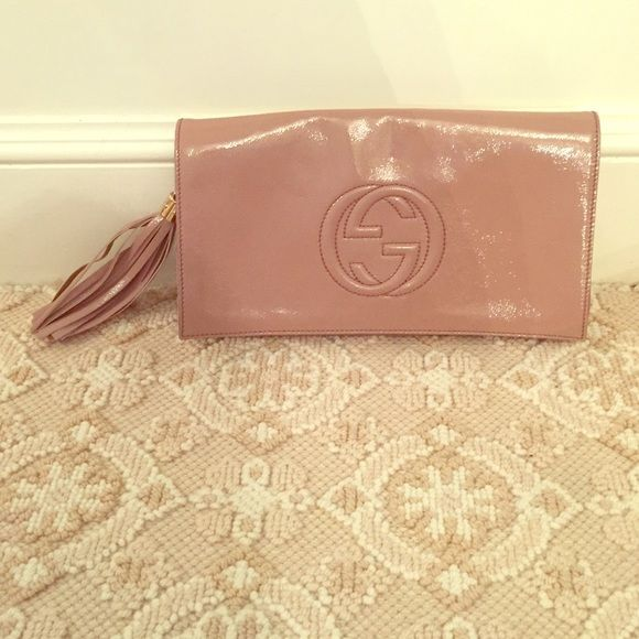 Blush Gucci clutch Blush colored leather Gucci clutch; LIGHTLY used- in great shape! Fringe attachment on the side is a very cool flare. Gucci Bags Clutches & Wristlets