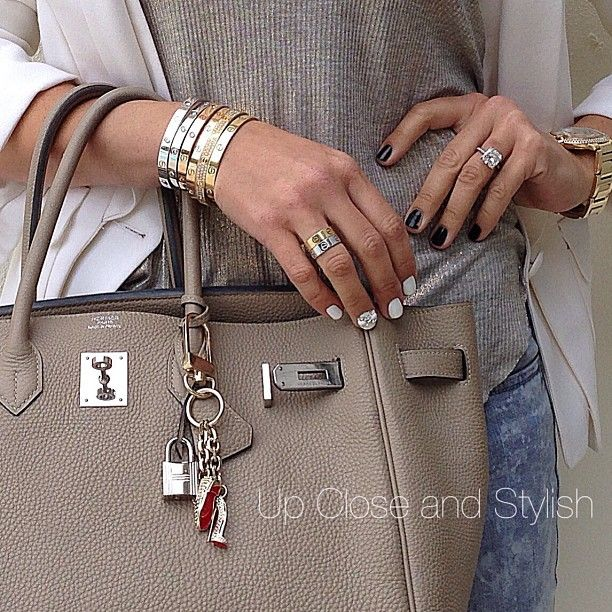 79b17f07b99  Hermès  Birkin 35 bag in Gris Tourterelle and a keychain from  Louboutin  used a a bag charm.