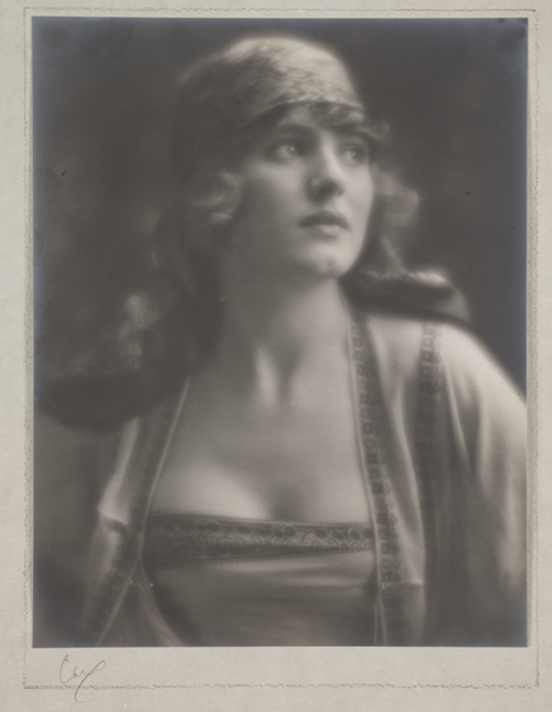 A platinum print photograph of a woman take by taken by George Edward Stanhope, 5th Earl of Carnarvon in 1918.