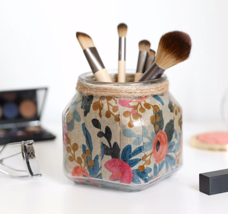 Upcycle a candle jar into a pretty and polished makeup