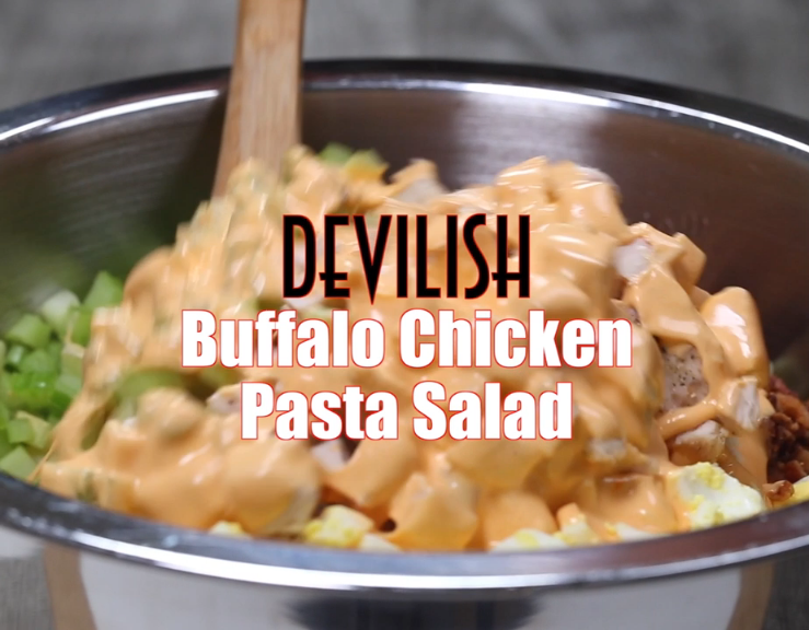This decadent Devilish Buffalo Chicken Pasta Salad is a side dish that eats like a meal! Loaded with bacon, hard boiled eggs and chicken tossed in a mild buffalo sauce! #buffalochickenpastasalad