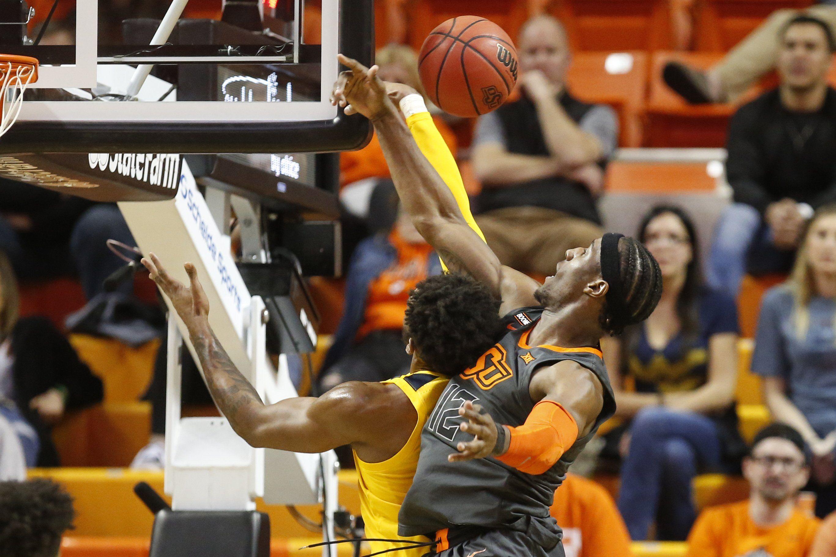 Balanced scoring, stifling defense lead WV over Okla. St