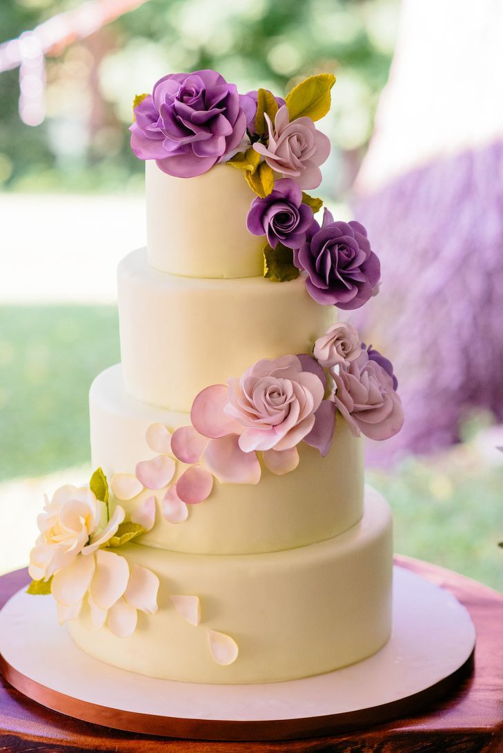 White Cake Decorated With Cascade Of Fondant Purple Ombre Flowers