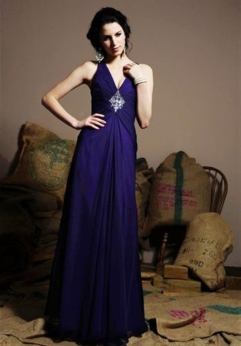 Dress features beading, ruching, and lace-up back.