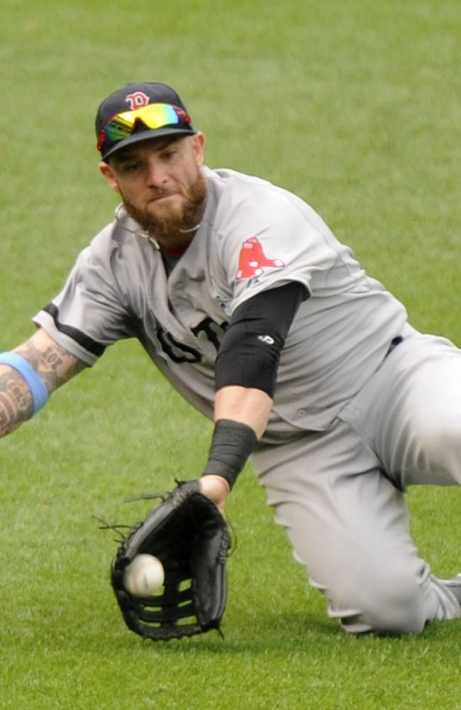 BALTIMORE, MD - JUNE 16: Jonny Gomes #5 of the Boston Red Sox slides to catch a fly ball hit by Steve Pearce #28 of the Baltimore Orioles the sixth inning during a baseball game on June 16, 2013 at Oriole Park at Camden Yards in Baltimore, Maryland. (Photo by Mitchell Layton/Getty Images)