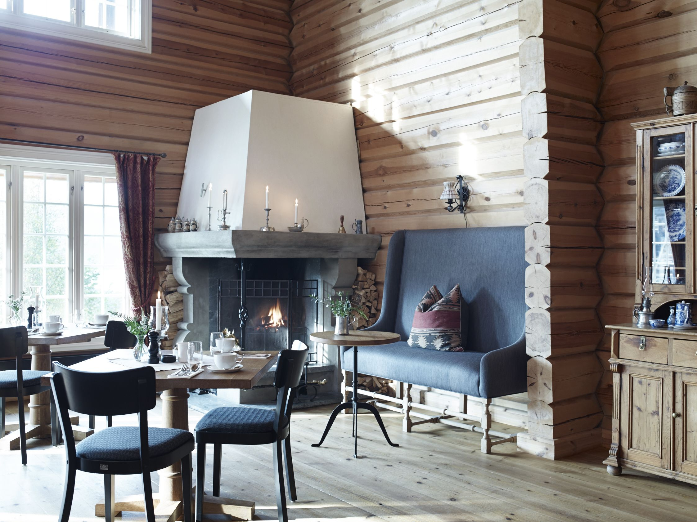 Dining Room With Open Fireplace At Storfjord Hotel