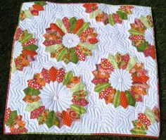 White Quilt with Colorful Flower Patterns free dresden plate pattern from Craftsy
