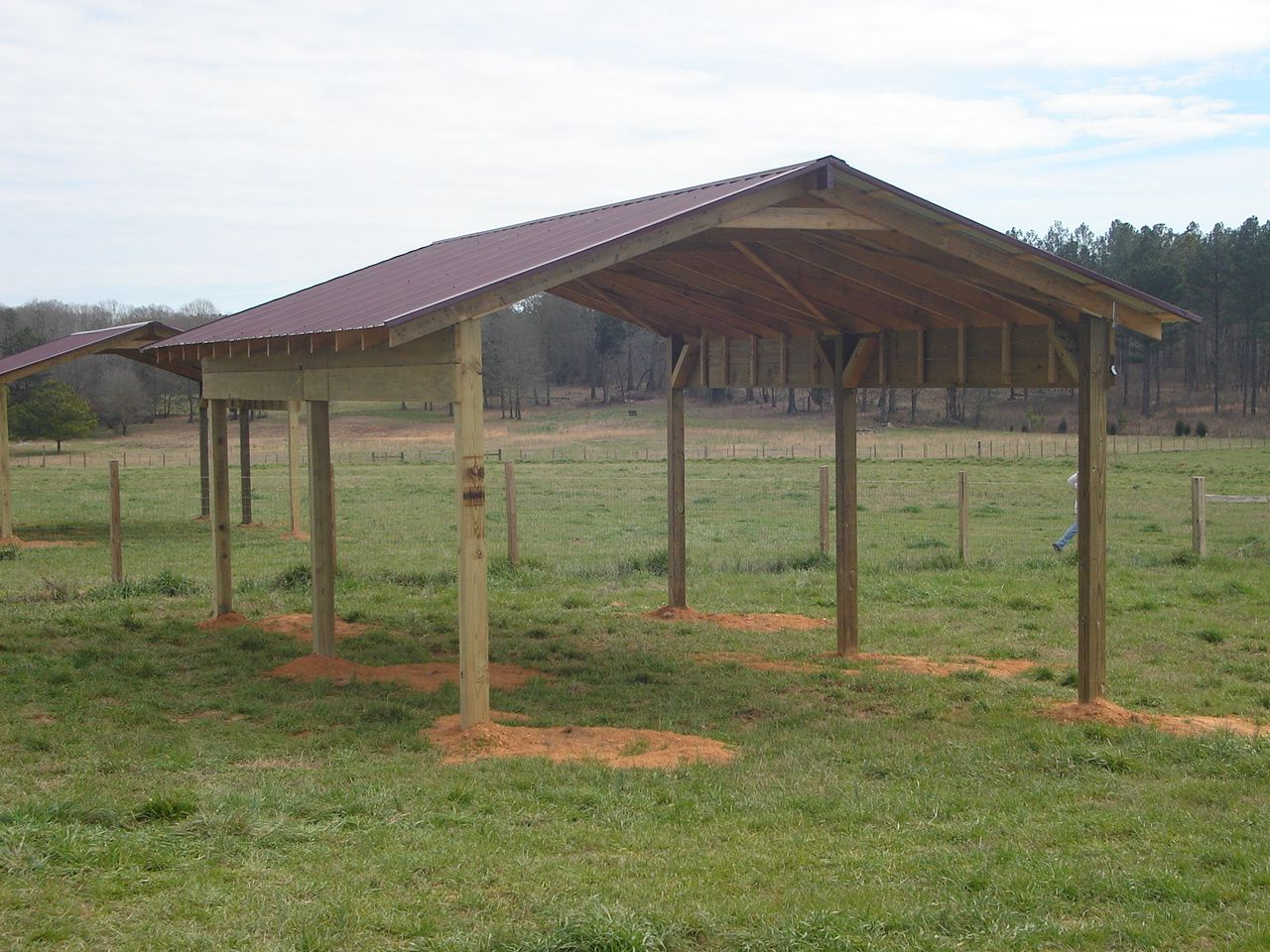 Simple pole barn shed pinterest for How to build pole barn house