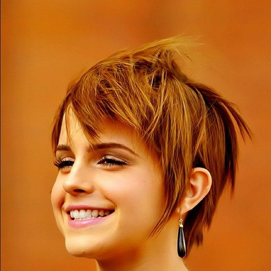 Emma Watson growing out pixie cut.