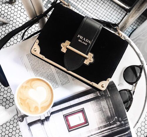 Prada mini velvet bag and a cappuccino on the desk #bags
