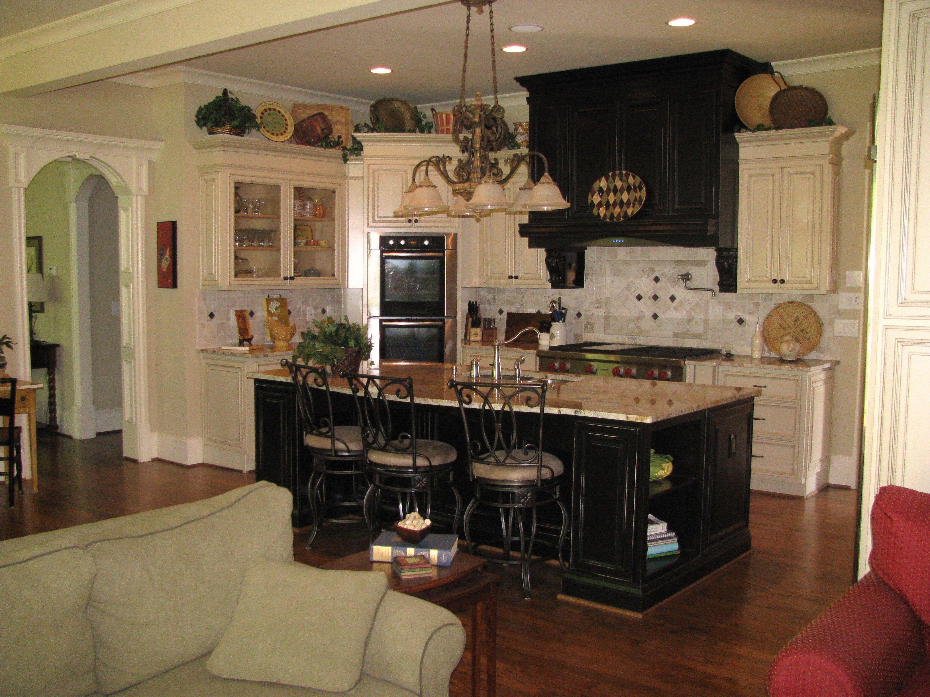 kitchen cabinets, wood floors, white trim. Nice open floor ...