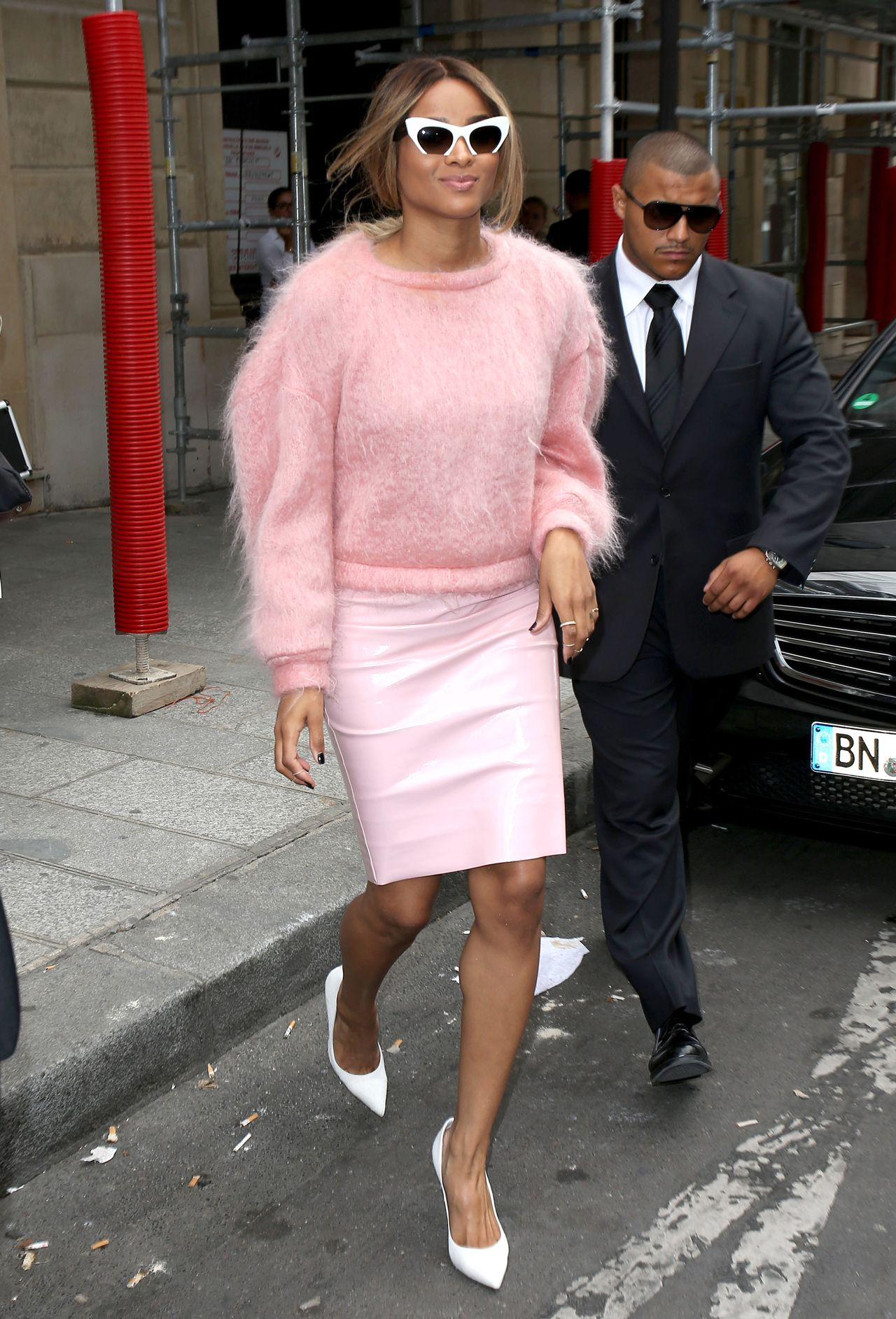 bubblegum pink sweater by Doriane Van Overeem and a vinyl skirt ...