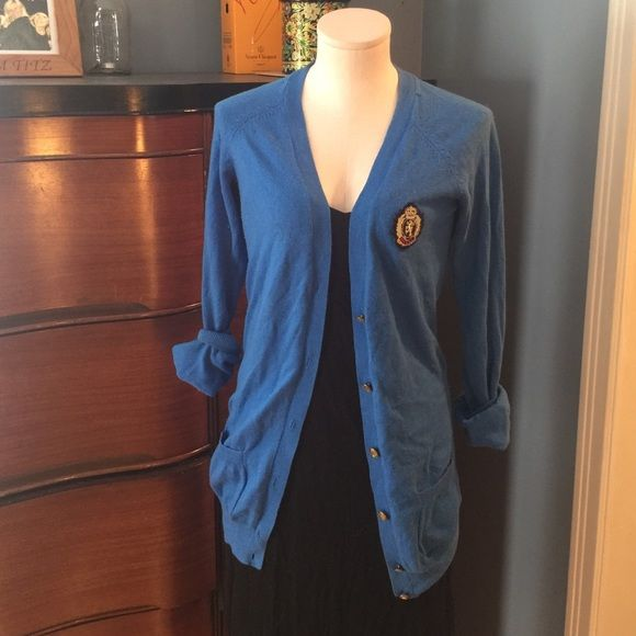 Blue cardigan Forever 21 size large, fits more like a medium, long blue cardigan. Has preppy emblem on chest, gold buttons. Light wear. Forever 21 Sweaters Cardigans