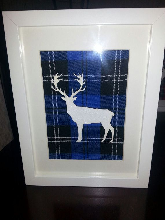 Add a Scottish theme to your home with this framed tartan reindeer. | 22 Stylish Products Every Reindeer Lover Needs In Their Home