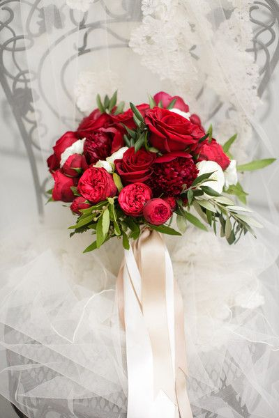 posh wedding bouquet showcasing red peonies red roses red piano spray roses - Red Garden Rose Bouquet