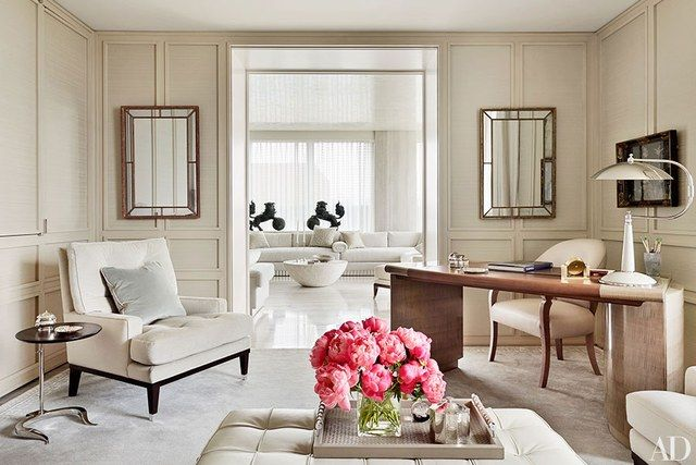 The library's club chair, clad in a Great Plains fabric, is from Ralph Pucci International, and the desk chair is by J. Robert Scott.