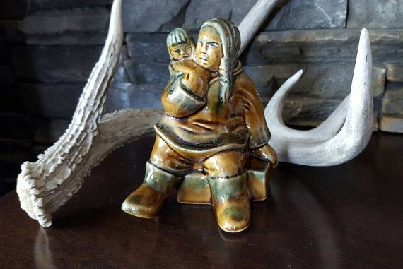 Canadian Inuit, Mother and Child, Ceramic Figurine, Green Golden Glaze, Baby in Amauti Poncho, Nunavut, Arctic, Aboriginal, Ceramic figurine of a mother and baby. The mother is carrying her baby in the traditional Amauti. Canada is embossed on the back of the piece and is a great piece of Canadian art.