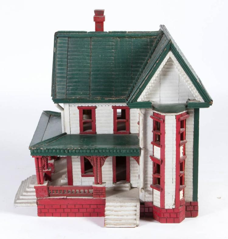 AMERICAN CARVED AND PAINTED PINE DOLLHOUSE