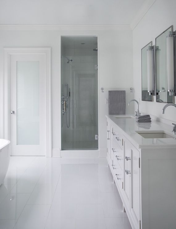 Sleek bathroom features a seamless glass door opening to a - Bathroom vanity with frosted glass doors ...