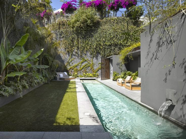 a long narrow lap pool and tiny patch of grass.