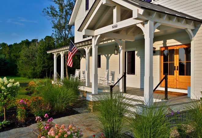 Farmhouse Porch. A traditionally styled farmhouse with all the comforts of a modern house. Farmhouse Porch #FarmhousePorch #Farmhouse #Porch Teakwood Builders, Inc. Scott Bergmann Photography