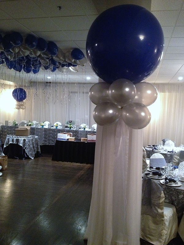 Midnight blue silver balloon ceiling for a baptism for Midnight blue centerpieces
