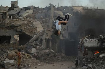 Palestinian Youth Perform Parkour In Gaza War Zone