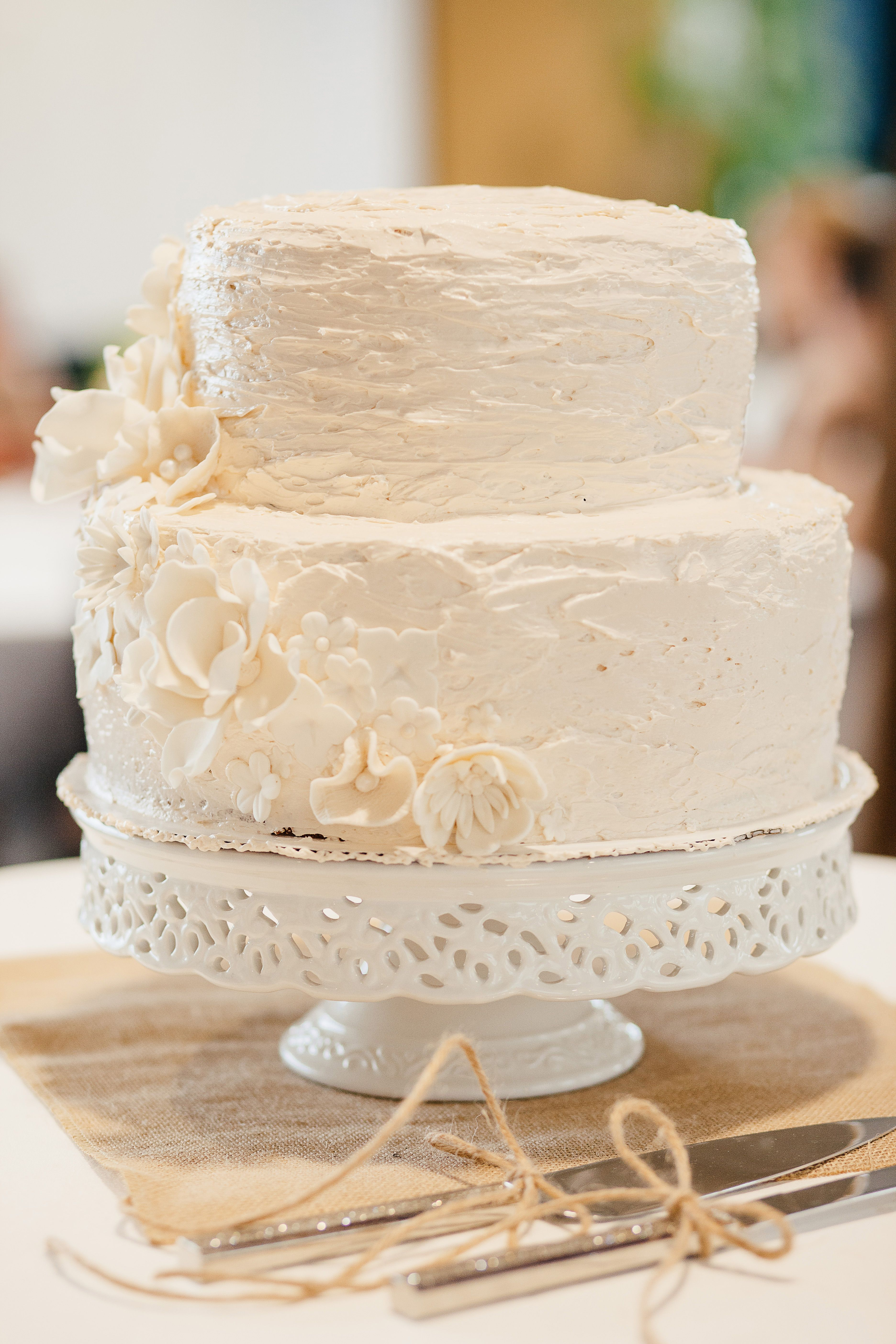 Simple cream and floral almond wedding cake | He Liked It So... He ...