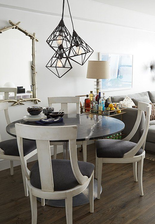 Inside A Glam Apartment Makeover Round Dining Room Sets Round Dining Room White Dining Room Chairs