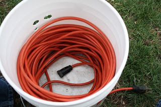 The Redeemed Gardener Cord In A Bucket How To Store Extension Cords Cord Storage Garage Storage Garage Storage Organization