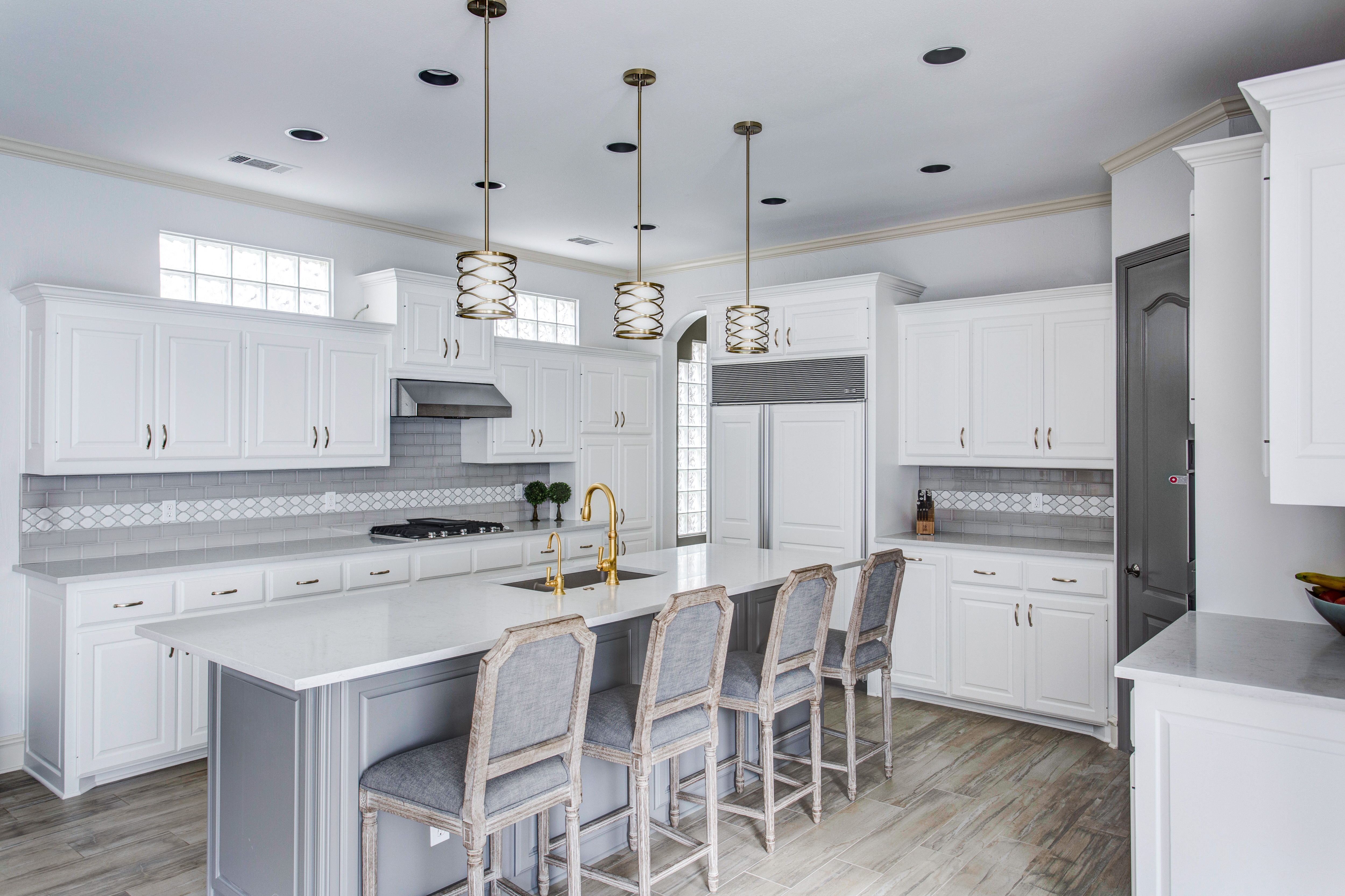 Grey and white kitchen. White cabinets with grey subway tile and a ...