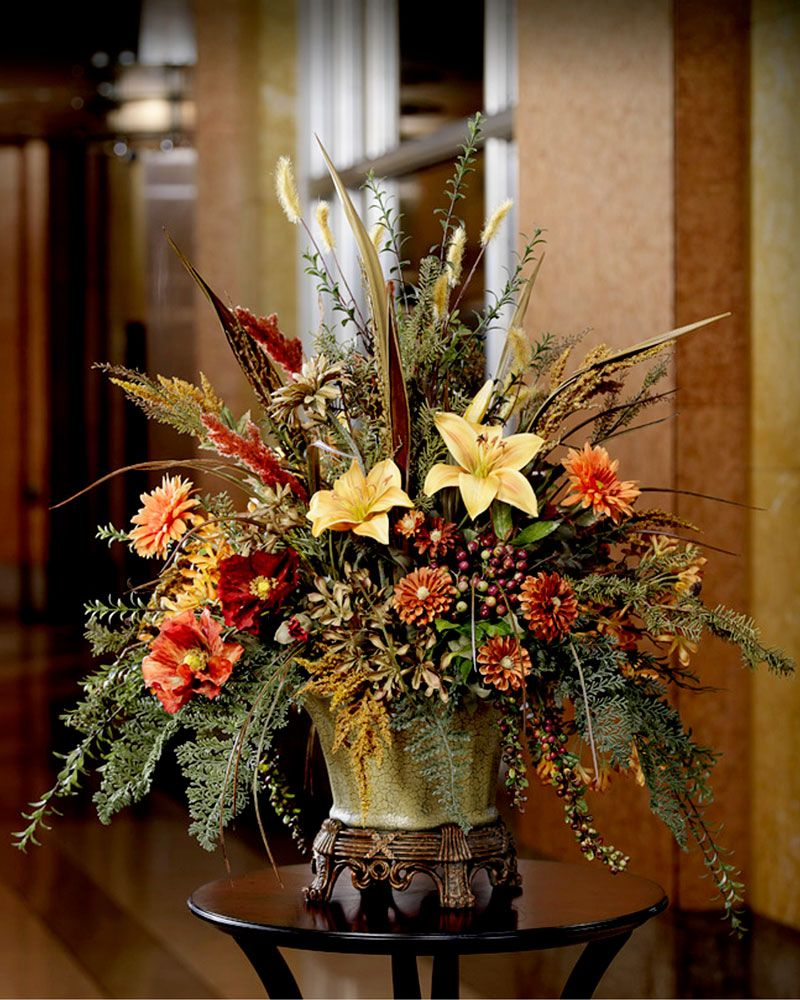 Infuse your living room entryway or dining area with a for Dinner table flower arrangements