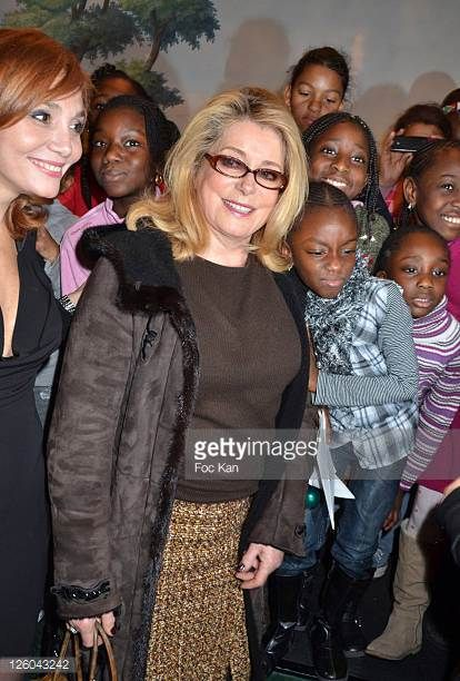 Journalist Sonita Nader actress Catherine Deneuve and kids attend the 'Charity Event For Children in Haiti' hosted by the CIRA at the Hotel Bristol...