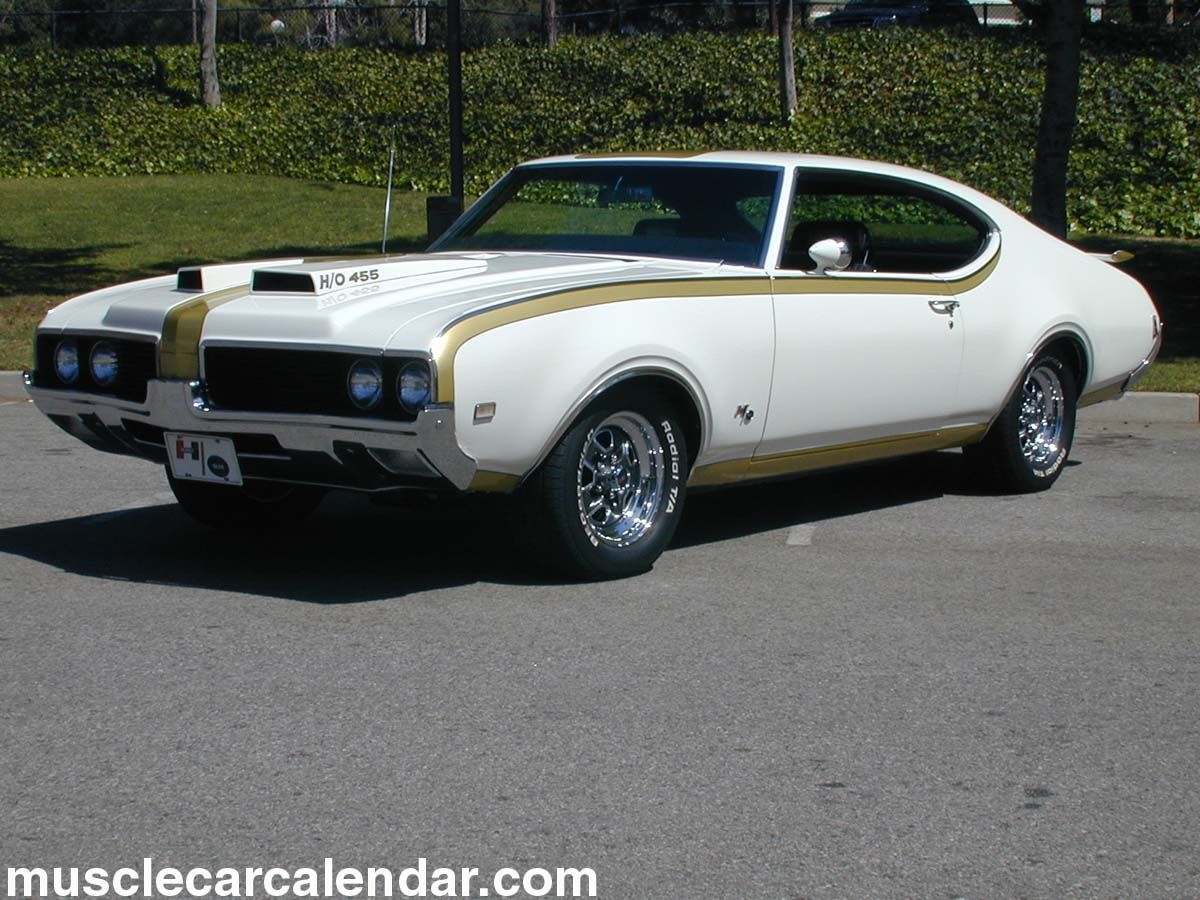 Presents a front left photograph of an impressive white 1969 oldsmobile hurst 455 coupe car