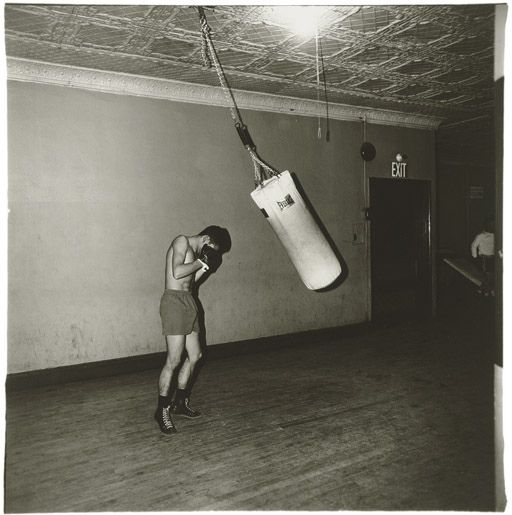 Diane Arbus, Boxer with a Punching Bag, NYC, 1964