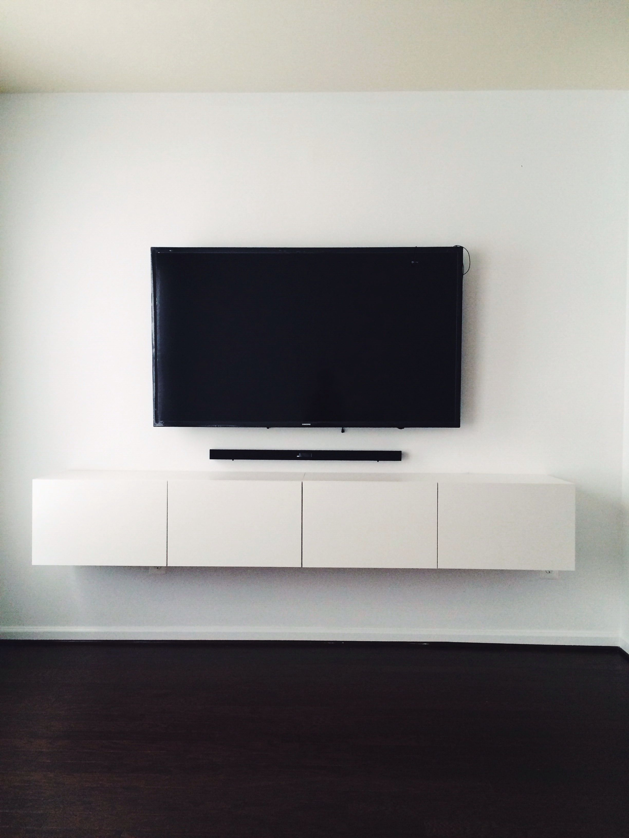 Tv board ikea holz  IKEA BESTÅ media console. Mounted tv with hidden wires. Now that's ...