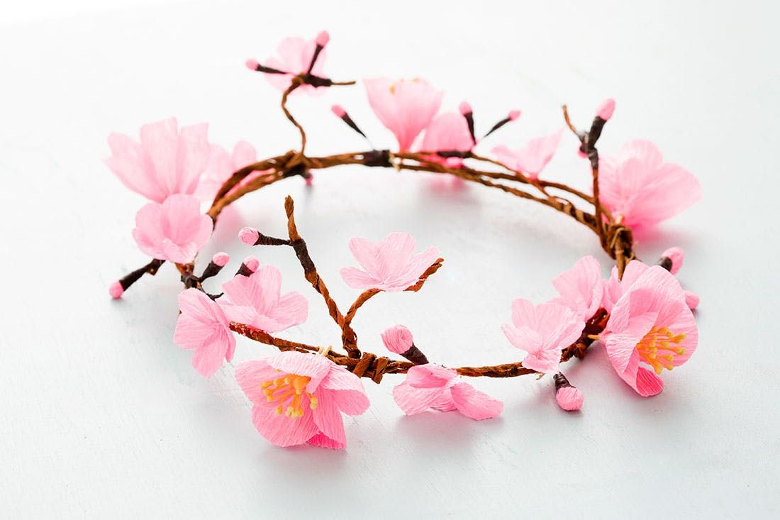 Paper Cherry Blossoms Make For The Prettiest Flower Crowns Cherry Blossom Flowers Cherry Blossom Party Cherry Blossom Theme