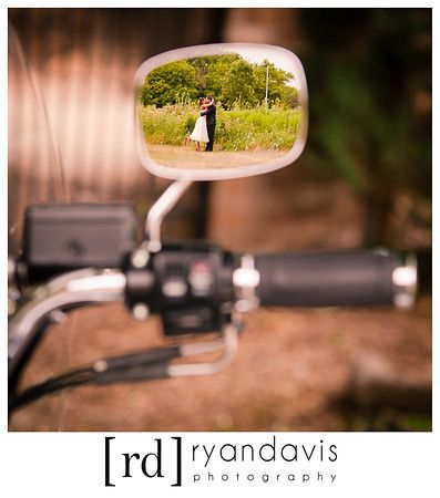 Bride and groom in the mirror of their Harley Davidson motorcycle after a wedding ... this will be awsome to do for me and my Fi for our wedding and hoping we can get a bike by then