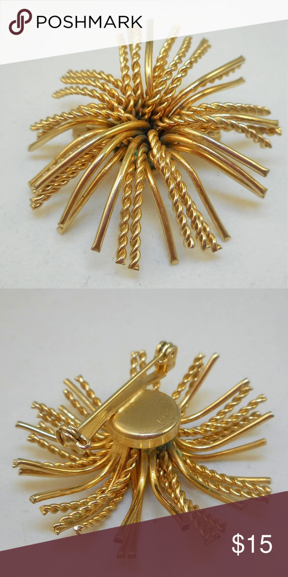"""Unusual Vintage Pin Super cute vintage pin that looks like a burst of fireworks. It consists of smooth and twisted strands of gold tone metal. It measures 1 3/4"""" and has a safety clasp in good working order. This is unsigned and in very good vintage condition. Jewelry Brooches"""