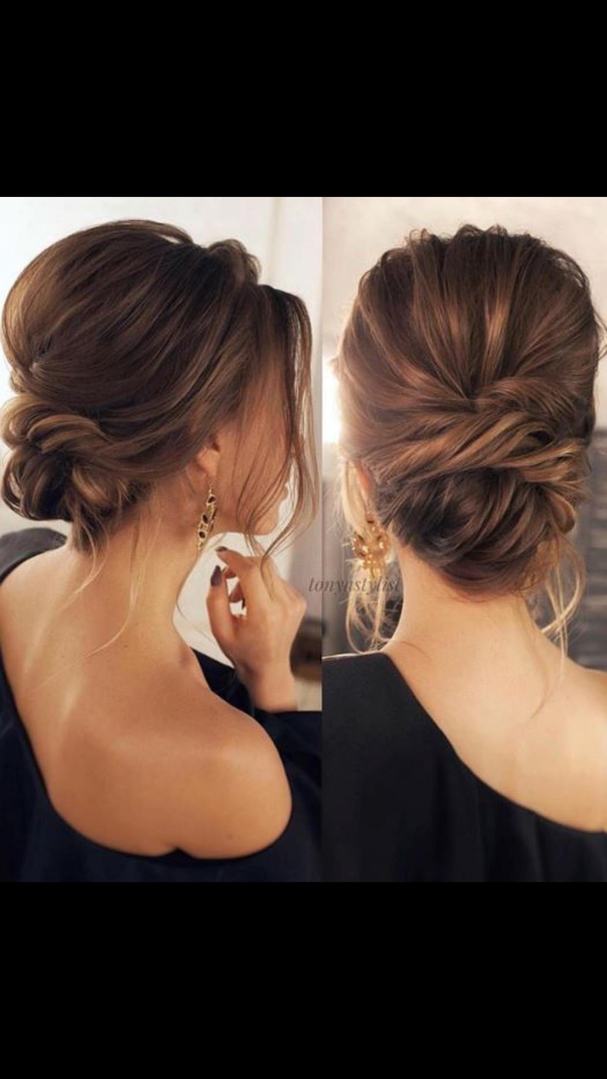 Pretty soft low bun updo bridal hair wedding hair