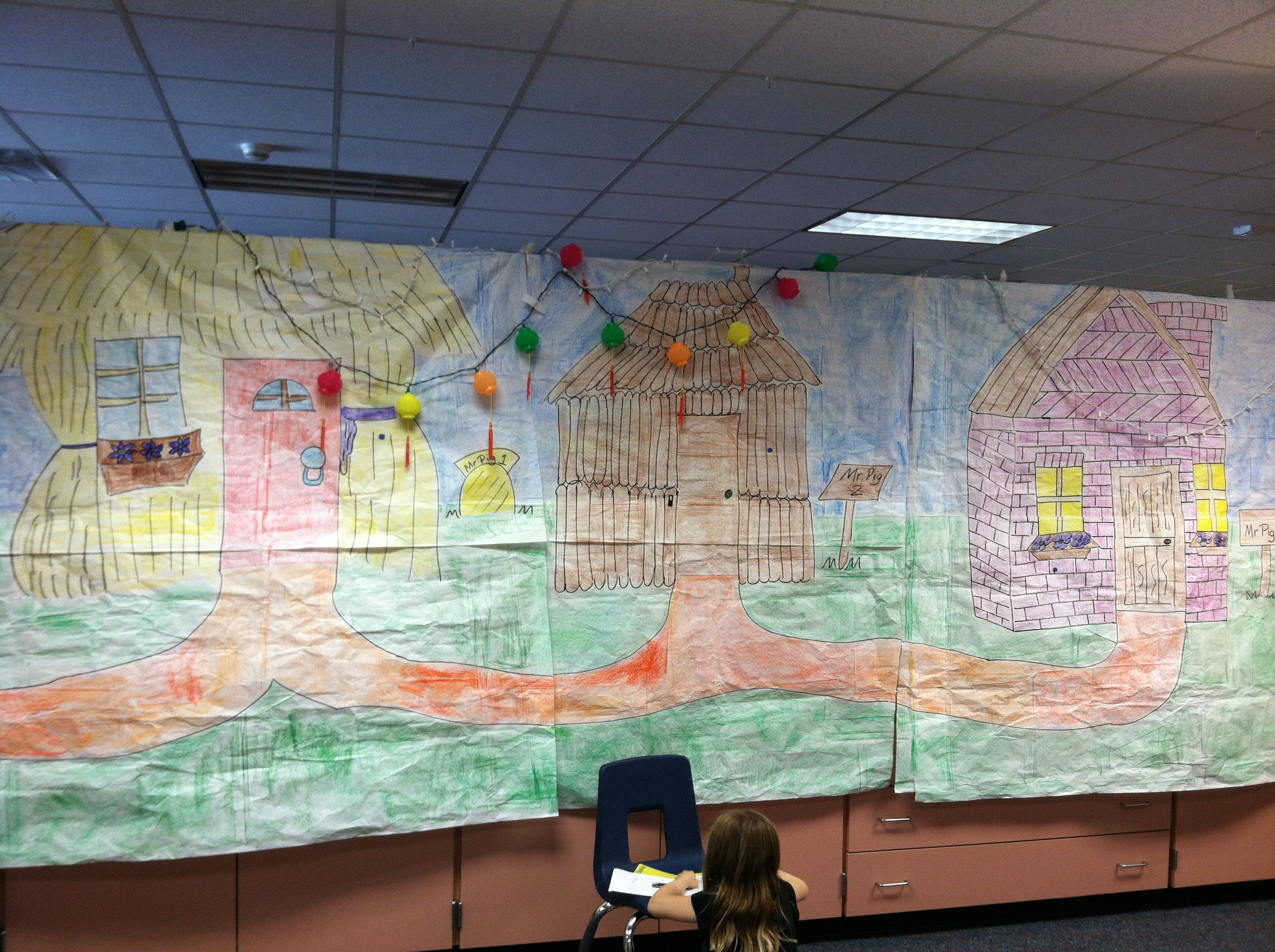 Three Little Pigs class play. Draw houses and have students to color on bulletin board paper.