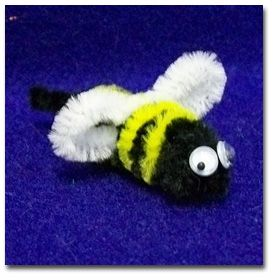 A bumble bee from pipe cleaners. Cut black pipecleaner 10