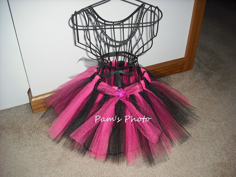 """16"""" inch  elastic waste band sewn into 15 1/2"""" inches. Tulle is 9"""" inches in length. Fushcia and Black Tulle. I added a bow with same color tulle and 1 gem.      6 - 12 months"""