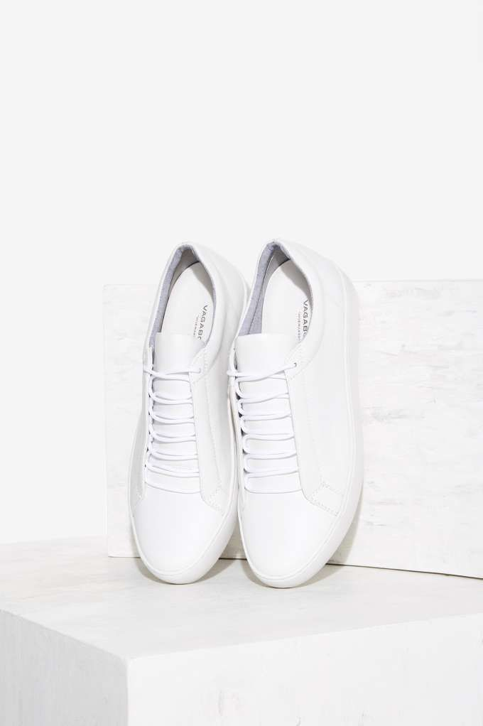 new style 7d25e b472f What can t you wear this with  The Zoe Sneaker is made in matte white  leather and features a minimal lace-up design, and padding at ankles.