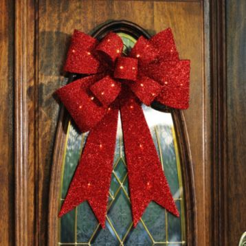 Add a touch of sparkle with our Pre-Lit Red Tinsel Bow! It is the perfect way to wrap up all of your holiday decor!