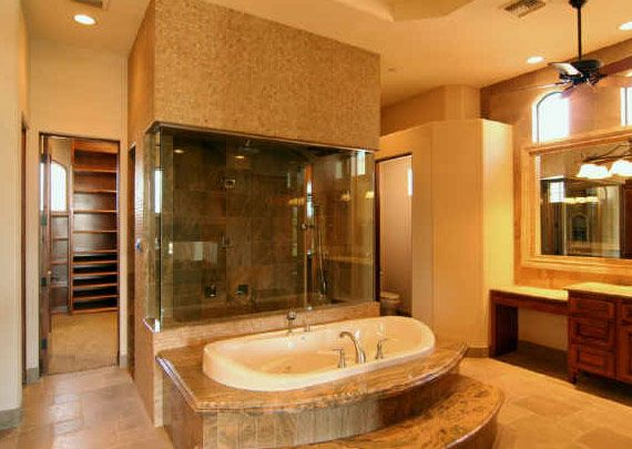 I love the idea of a walk through shower behind the tub. Just add a ...