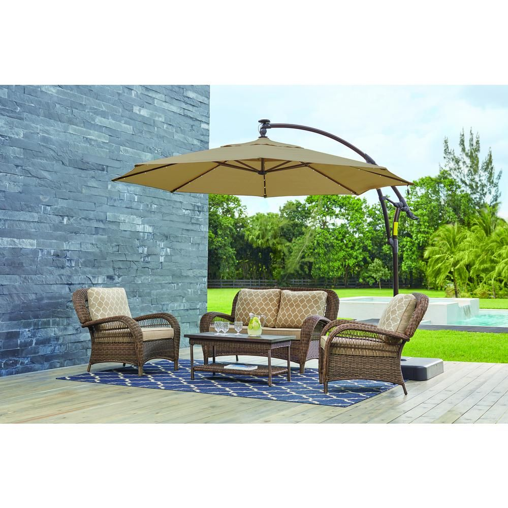 Hampton Bay 11 Ft Led Round Offset Outdoor Patio Umbrella In Sunbrella Sand Yjaf052 A Patio Outdoor Patio Umbrellas Patio Umbrella