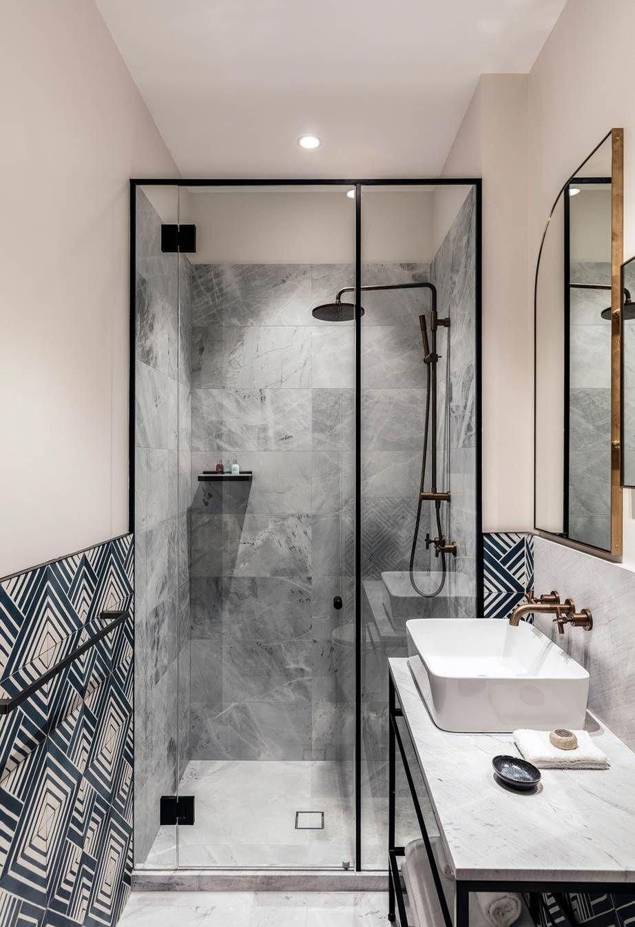 Bathroom With Navy And White Geometric Tiles Paired With Marble Vanity The Shower Stall Is Tiled In Boutique Bathroom Ensuite Bathroom Designs Bathroom Design