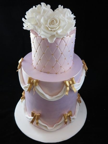 Pink, White and Gold Extended Tier Wedding Cake with Roses  http://www.sweetthingsbylaura.com