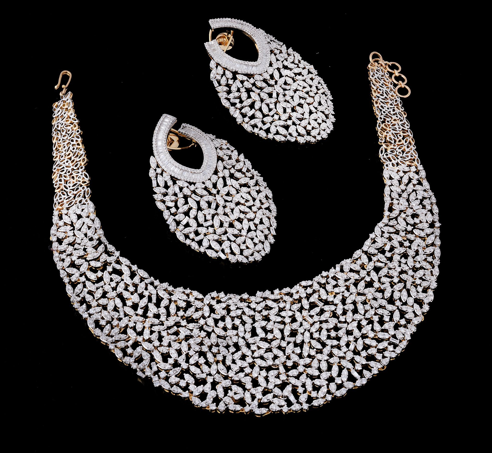 A diamond necklace and ear pendents suite. Sold for £11,160 at Dreweatts & Bloomsbury Auctions' Fine Jewellery sale on 27th November 2014